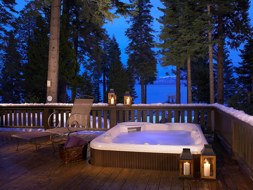 Using a hot tub in winter - evening tree image
