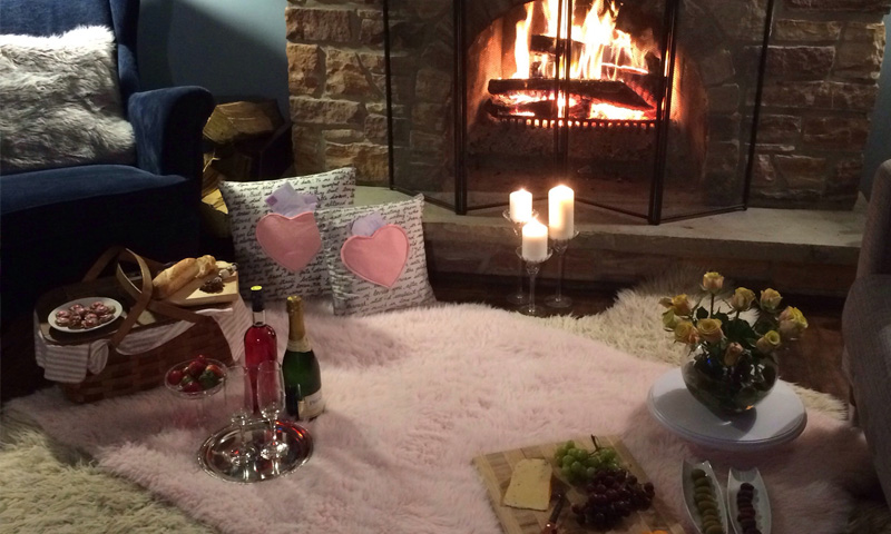 Romantic ideas at home this Valentine's Day fire side picnic image